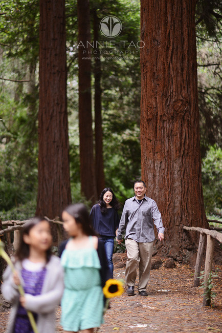 San-Francisco-lifestyle-family-photography-couple-walking-behind-kids-in-forest