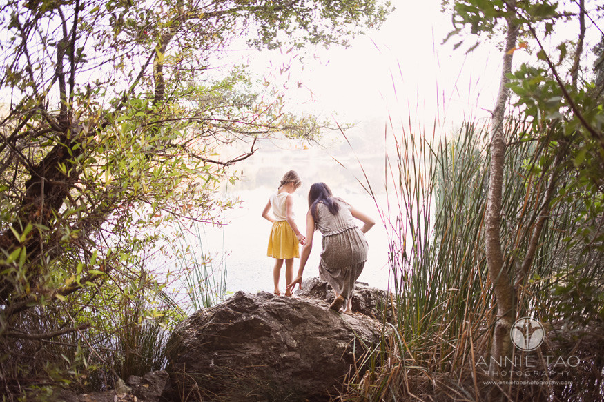 Bay-Area-lifestyle-family-photography-mom-and-daughter-climbing-on-rock-by-lake