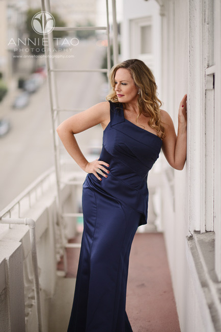 San-Francisco-couple-styled-photography-woman-in-blue-long-dress-on-fire-escape