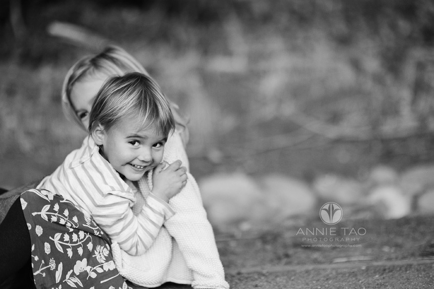 San-Francisco-lifestyle-children-photography-young-girl-looking-at-camera-during-a-sister-hug-BxW