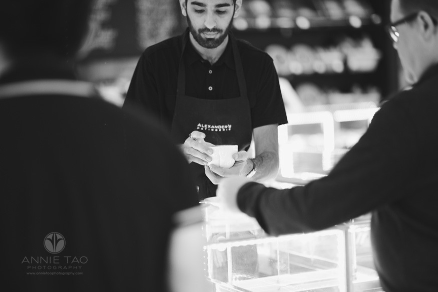 Bay-Area-lifestyle-photography-man-retrieving-coffee-at-counter-BxW