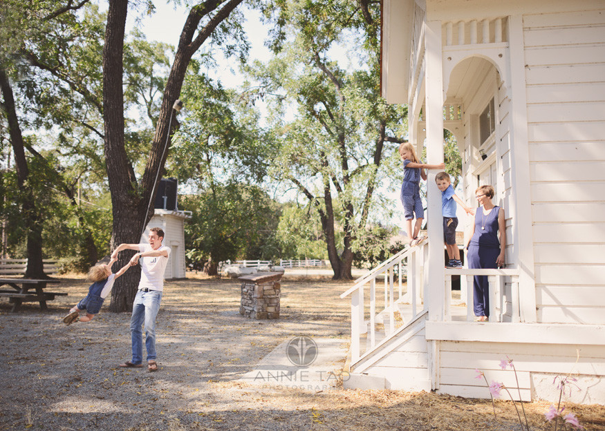 East-Bay-lifestyle-family-photography-family-playing-by-white-schoolhouse