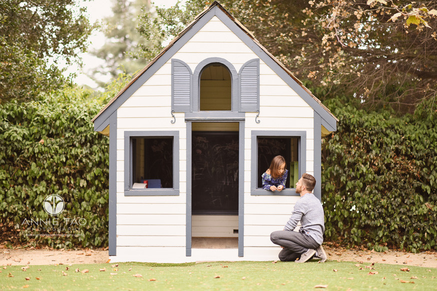 San-Francisco-Bay-Area-commercial-photography-lifemoves-father-kneeling-on-ground-while-talking-with-daughter-in-playhouse-window