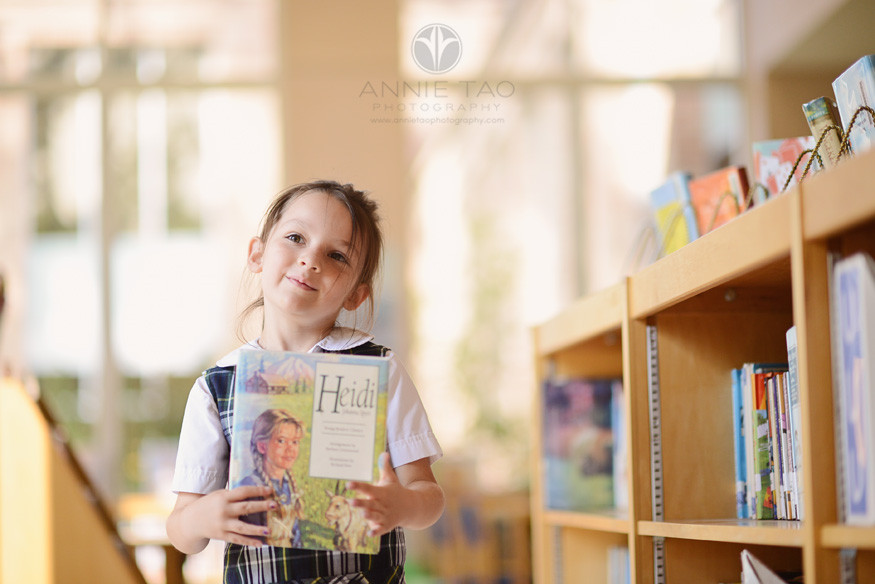 Commercial-education-photography-young-student-happy-about-choosing-a-book-in-library