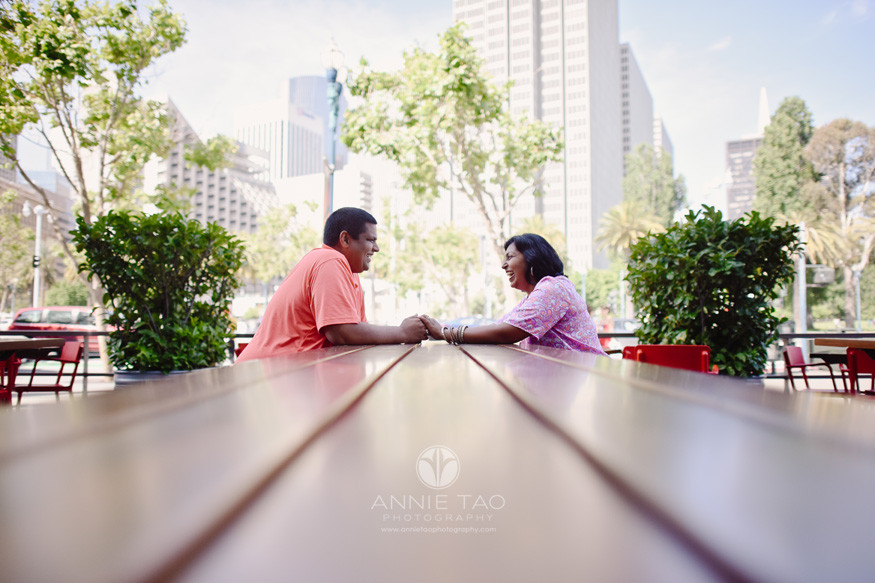 San-Francisco-lifestyle-couple-photography-couple-holding-hands-at-table-downtown