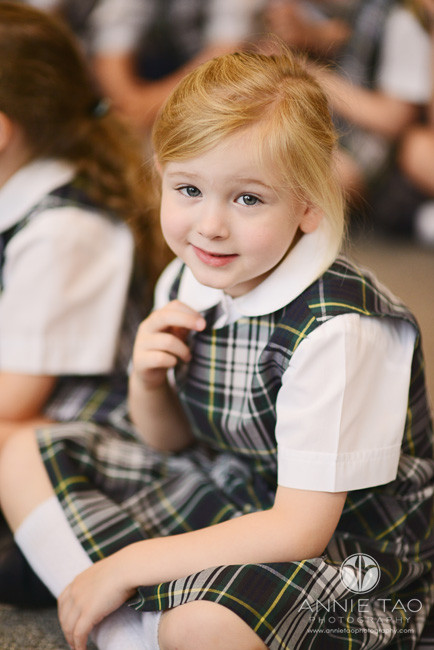 Commercial-education-photography-young-blonde-girl-smiling-during-assembly