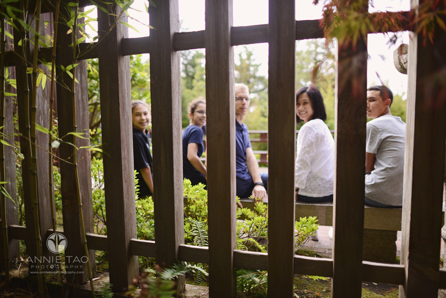 San-Francisco-lifestyle-family-photography-family-turned-around-on-bench-view-through-fence