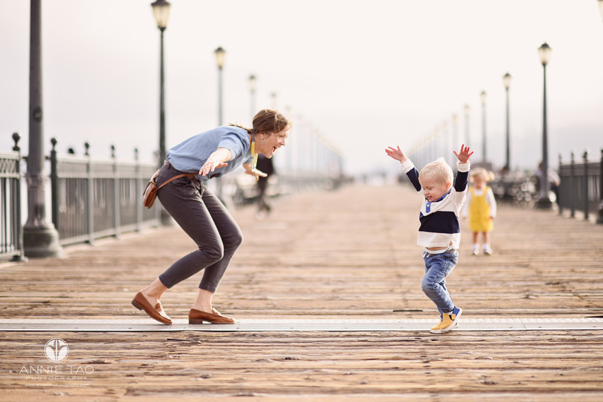 San-Francisco-lifestyle-family-photography-mother-and-toddler-son-being-airplanes-on-pier