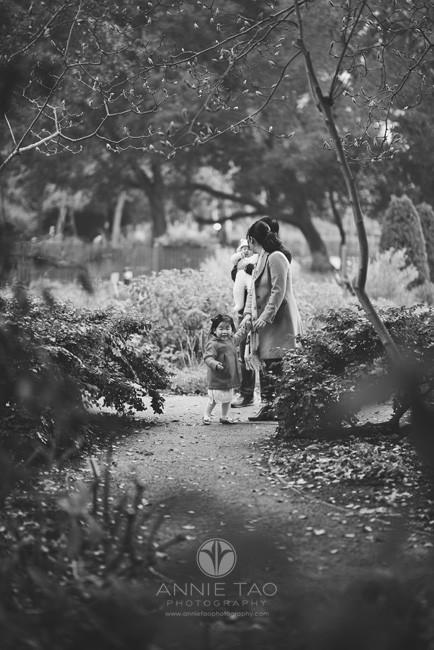 Bay-Area-Palo-Alto-lifestyle-family-photography-toddler-girl-pulling-mom-and-leading-family-down-path-BxW