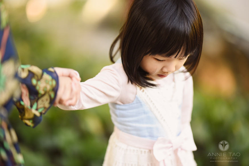 East-Bay-lifestyle-children-photography-toddler-girl-looking-down-while-holding-moms-hand