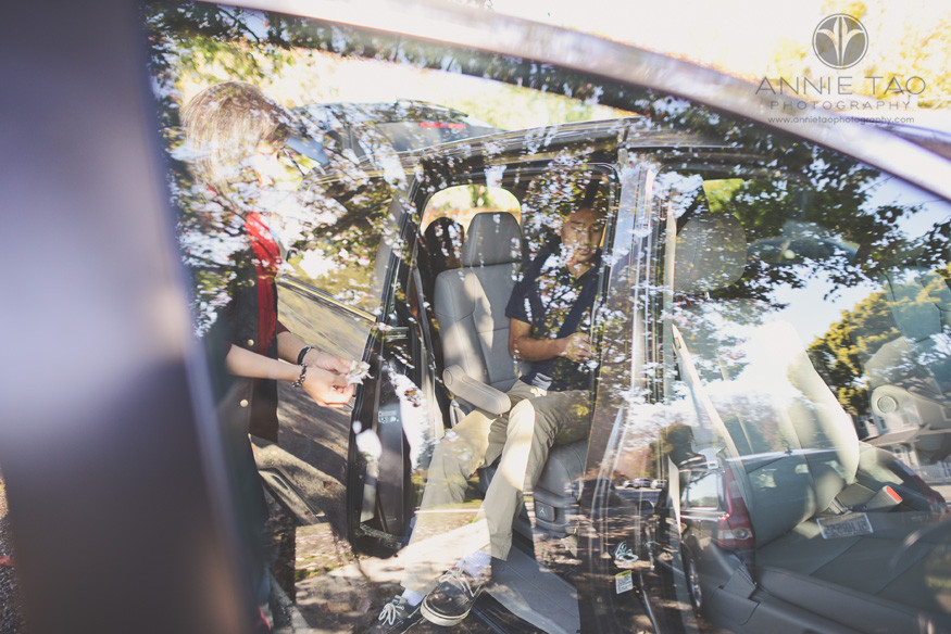 South-Bay-lifestyle-family-photography-mom-cleaning-teen-sons-shoes-at-car