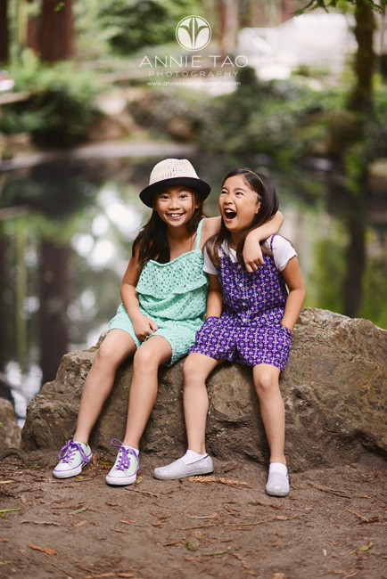 San-Francisco-lifestyle-children-photography-sisters-sitting-on-rock-and-goofing-around-2