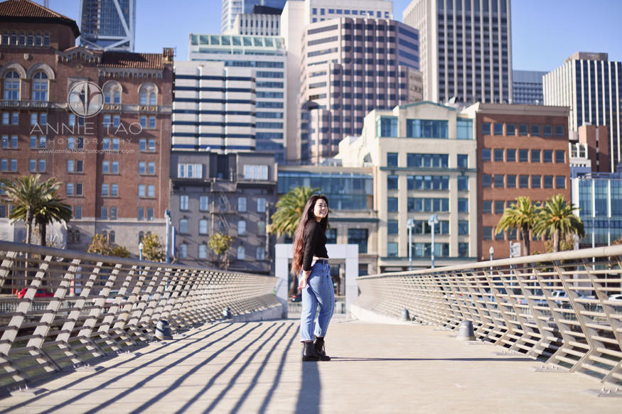 San-Francisco-senior-photography-teen-girl-turning-around-on-pier-by-city