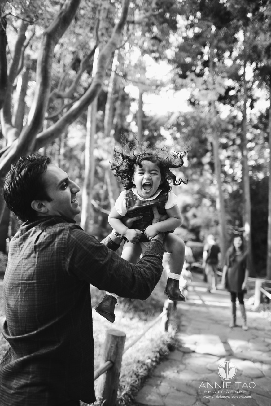 San-Francisco-lifestyle-family-photography-man-throwing-daughter-in-air-BxW