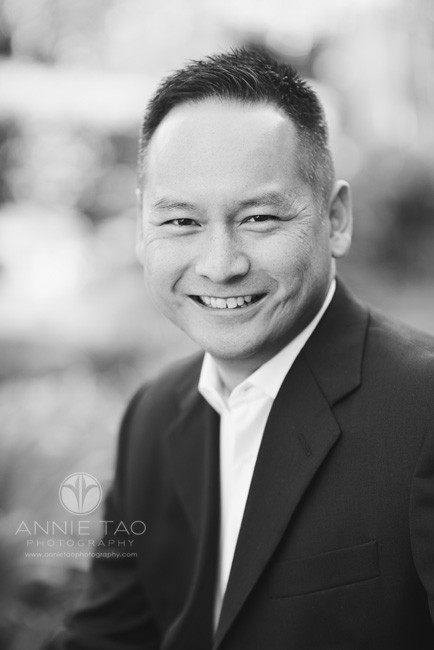 East-Bay-commercial-photography-corporate-headshot-man-in-black-suit-and-garden-background-BxW
