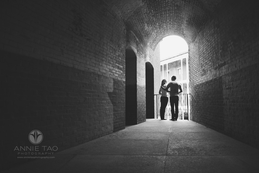 San-Francisco-lifestyle-family-photography-couple-standing-by-the-fence-in-a-long-tunnel-BxW