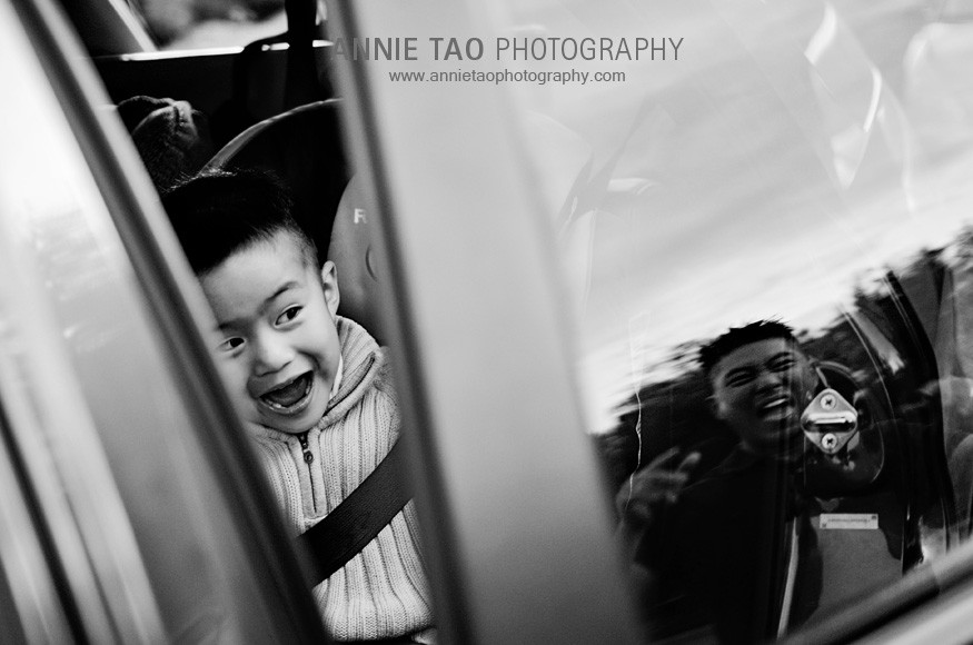 East-Bay-lifestyle-family-photography-preschooler-in-car-with-dad-making-funny-face