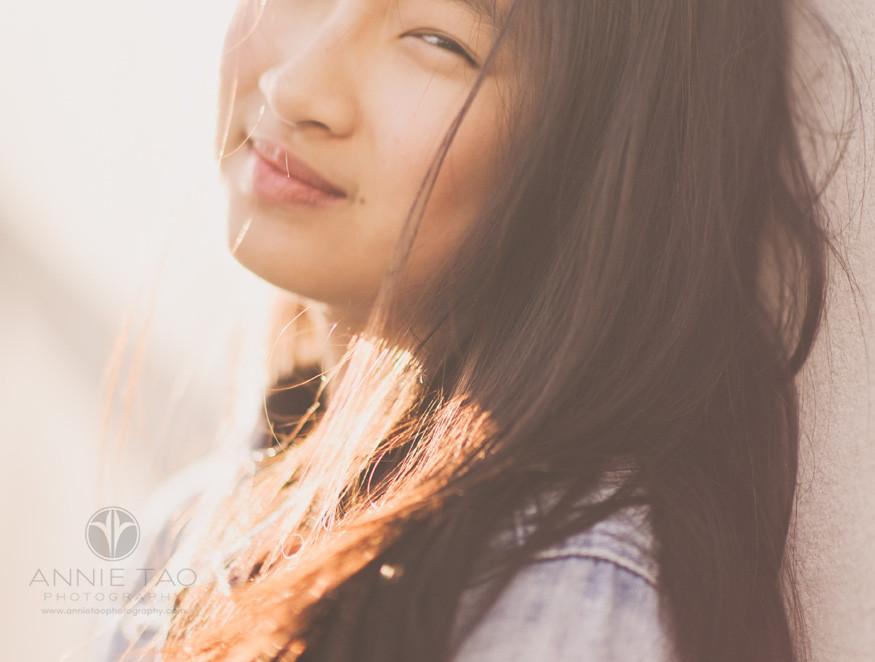 East-Bay-lifestyle-teen-photography-girl-headshot-windblown-hair-sunflare