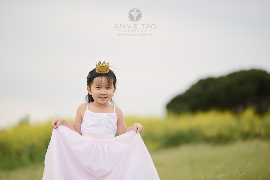 East-Bay-styled-children-photography-princess-with-gold-crown-doing-a-curtsy