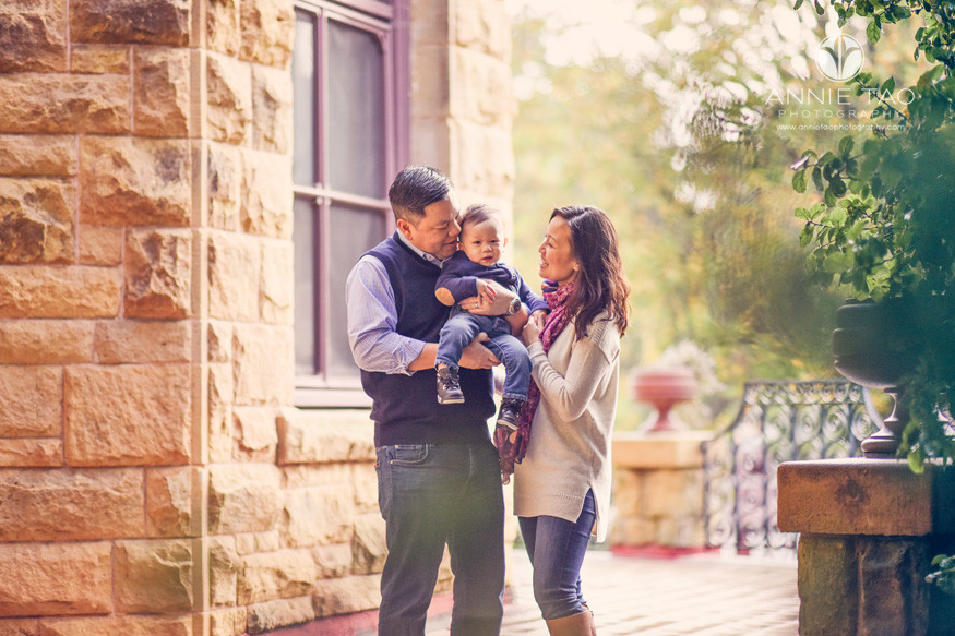 San-Francisco-lifestyle-family-photography-cuddling-baby-by-stone-building-and-trees