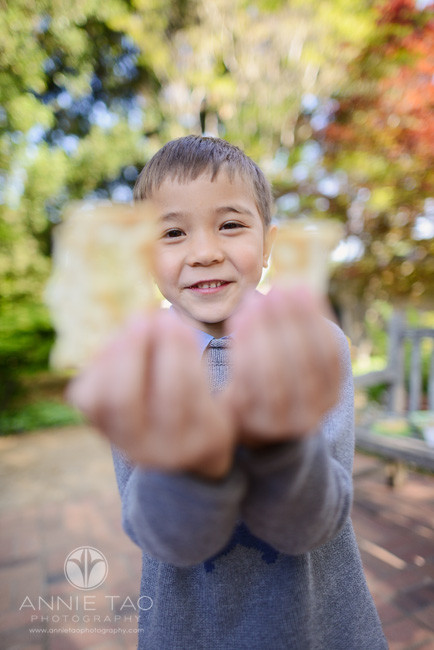 San-Francisco-Bay-Area-lifestyle-children-photography-young-boy-holding-up-crackers