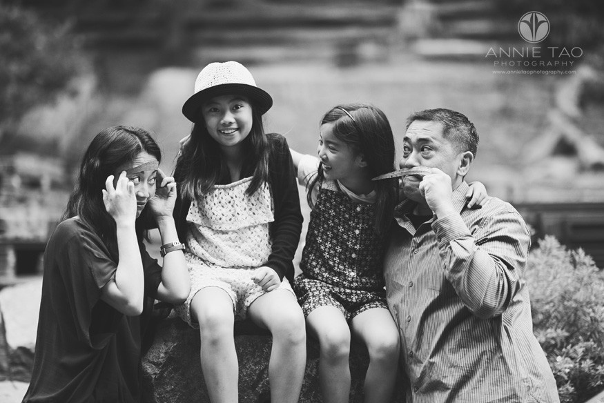 San-Francisco-lifestyle-family-photography-parents-being-silly-while-daughters-look-on-BxW