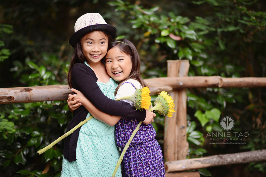San-Francisco-lifestyle-children-photography-sisters-hugging-tightly-and-laughing