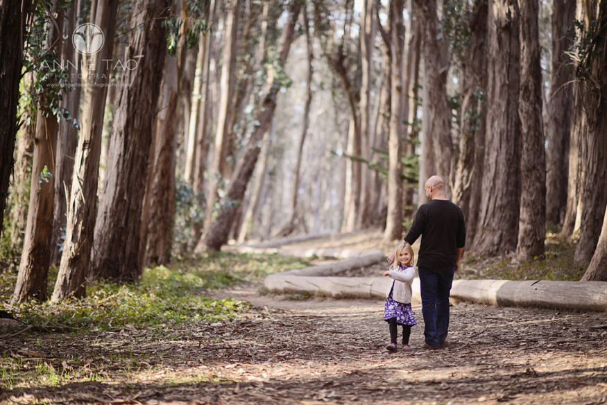 San-Francisco-lifestyle-family-photography-father-holding-daughters-hand-in-woods-lg