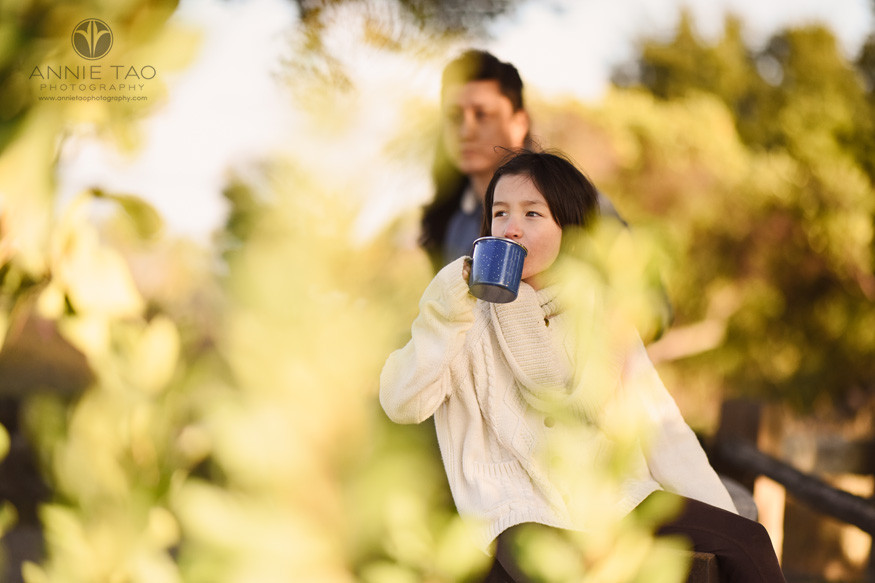 San-Francisco-bay-area-lifestyle-children-photography-girl-sipping-from-mug-framed-by-golden-leaves