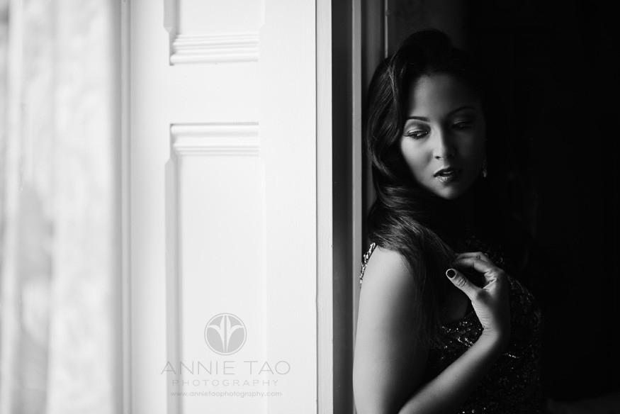 East-Bay-styled-photography-commercial-photography-tammy-brawner-standing-by-the-window-and-looking-down-BxW