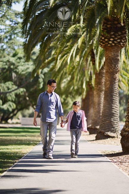 Bay-Area-lifestyle-children-photography-young-son-holding-fathers-hand-on-sidewalk
