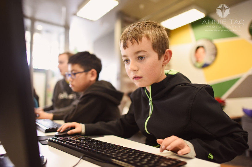san-mateo-peninsula-commercial-photography-young-boy-focused-on-screen-in-coding-class