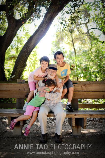 Palo-Alto-lifestyle-family-photography-three-kids-hugging-grandfather