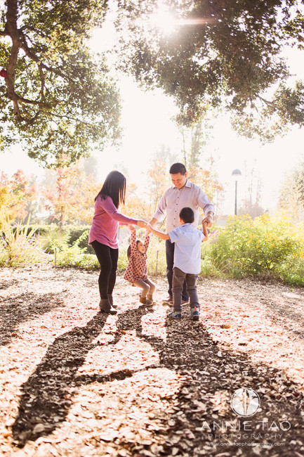 san-francisco-bay-area-lifestyle-family-photography-family-holding-hands-in-a-circle-in-garden