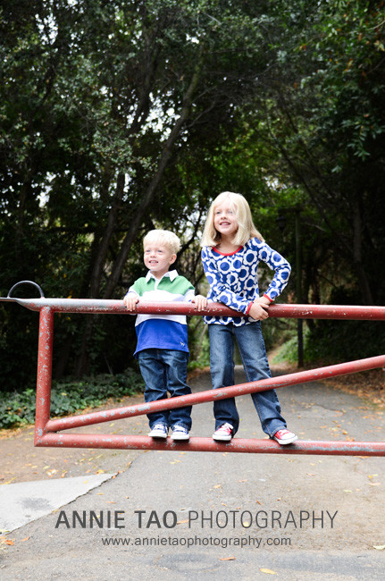 East-Bay-lifestyle-family-photography-kids-smiling-while-standing-on-gate