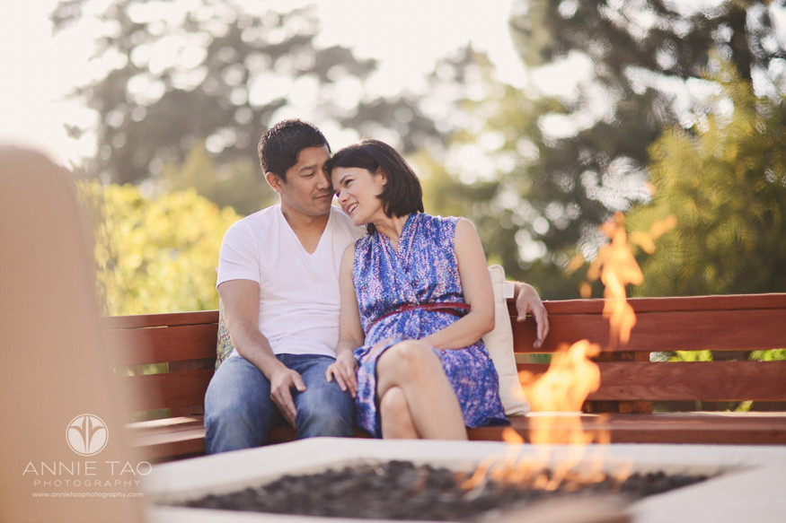 East-Bay-lifestyle-photography-couple-leaning-into-one-another-by-firepit