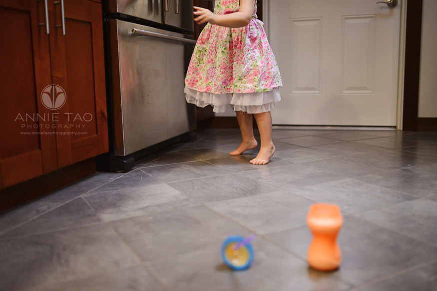 North-Bay-Marin-lifestyle-children-photography-toddler-girl-putting-away-milk-in-fridge-on-tippy-toes