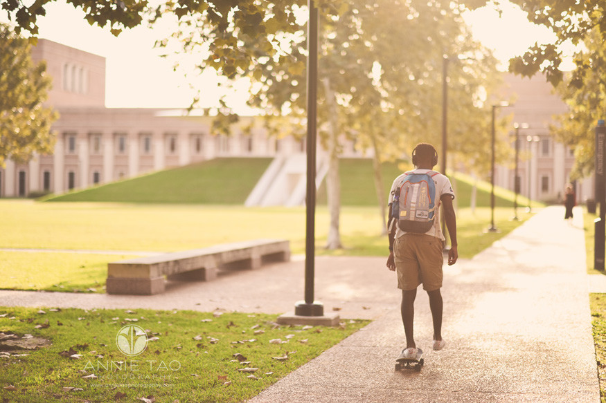 Houston-commercial-photography-student-riding-skateboard-campus-at-sunset