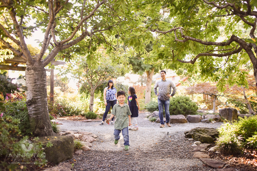 Bay-Area-lifestyle-family-photography-family-hangs-behind-while-preschool-boy-walks-forward-in-garden