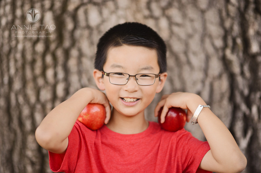 east-bay-styled-children-photography-boy-in-red-holding-two-apples-on-shoulders