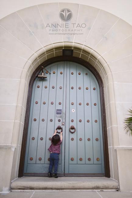 San-Francisco-lifestyle-children-photography-toddler-girl-knocking-on-giant-door