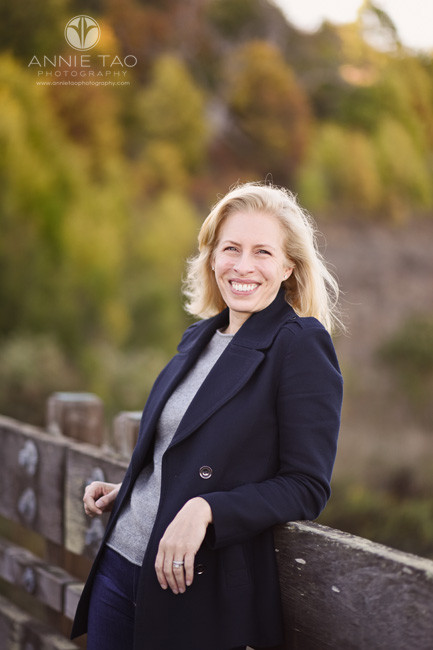 South-Bay-lifestyle-photography-blonde-woman-smiling-while-leaning-back-on-wooden-bridge