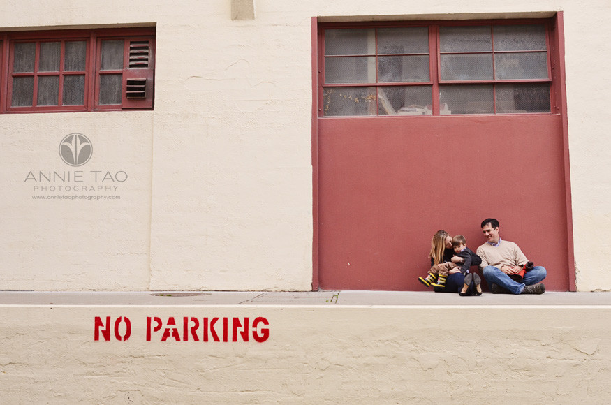 San-Francisco-Bay-Area-lifestyle-family-photography-sitting-by-a-warehouse-and-No-Parking-sign
