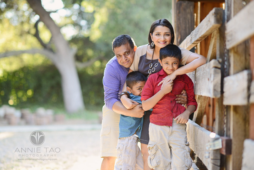 East-Bay-lifestyle-family-photography-family-giving-a-big-hug-by-a-barn