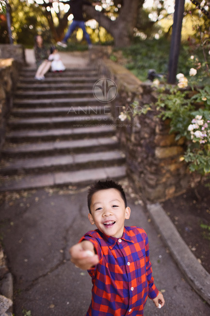 East-Bay-lifestyle-children-photography-boy-reaching-up-to-give-candy-to-photographer