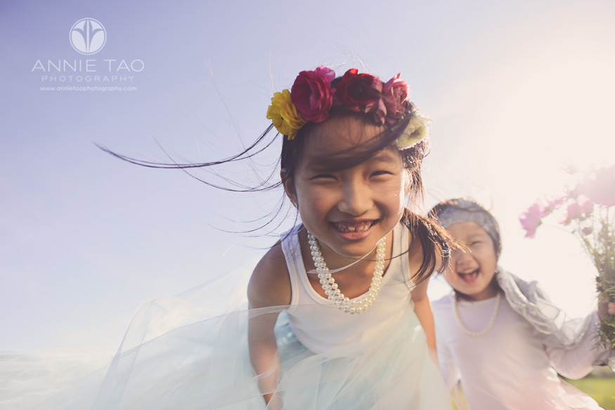 East-Bay-styled-children-photography-sisters-laughing-into-the-camera-with-sunflare