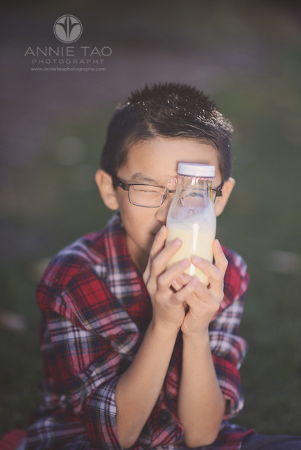 East-Bay-children-lifestyle-photography-boy-seeing-through-glass-bottle