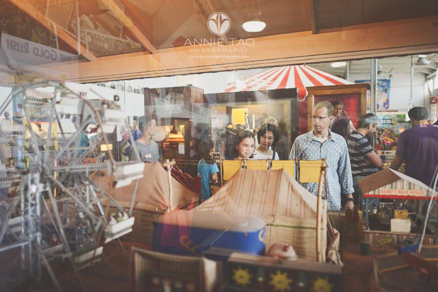 San-Francisco-lifestyle-family-photography-family-walking-through-arcade-view-thru-glass