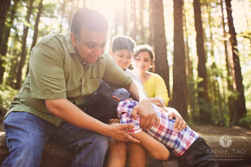 East-Bay-lifestyle-family-photography-family-tickling-son-in-redwood-forest