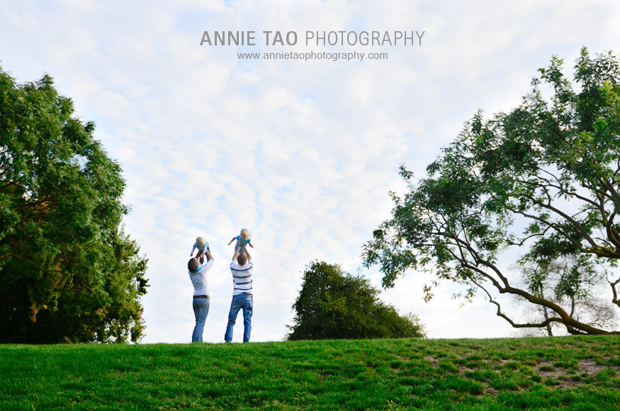 East-Bay-lifestyle-family-photography-family-playing-on-a-grassy-hill-distance